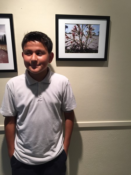 City Hearts student Joshua with his photo.