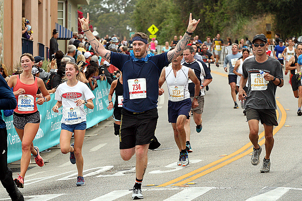 . Wharf to Wharf racers eye the finish line as they run down the hill into Capitola Village. (Dan Coyro -- Santa Cruz Sentinel)