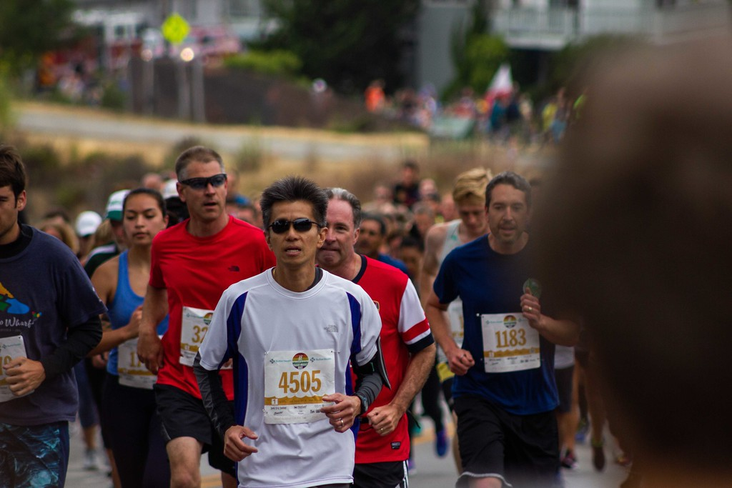 . People participating in the 46th Annual Wharf to Wharf Race. Runners started at the Santa Cruz Wharf on Beach Street and continued along the coast finishing the race at the Capitola Wharf on East Cliff Drive. (Marcello Hutchinson-Trujillo � Santa Cruz Sentinel)