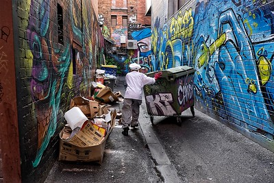 Paynes Pl, chef pushes rubbish bin towards Croft Alley