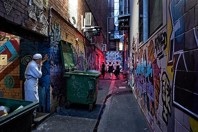 Croft Alley, three club goers on there way to the Croft institue night club as a chef taking a smoko break from another restaurant looks on.