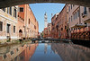 BACK SEAT TAXI VIEW CRUISING UNDER AN ARCH THROUGH A CANAL IN VENICE