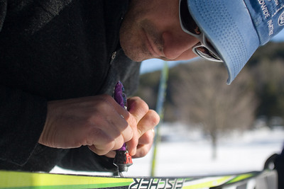 Ed Merrens of Ford Sayre prepares to put klister wax on a pair of classic Nordic skis at a Bill Koch League kids race in Woodstock, Vermont
