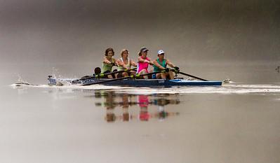 The Upper Valley Rowing Foundation's Women's heavyweight Master's 4 plows through morning fog on the Connecticut River