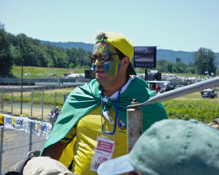 Brazilian racefan at the Portland International Raceway for a Champ Car race.  I think the old gent qualifies as the more avid fan, but this guy was pretty entertaining.
