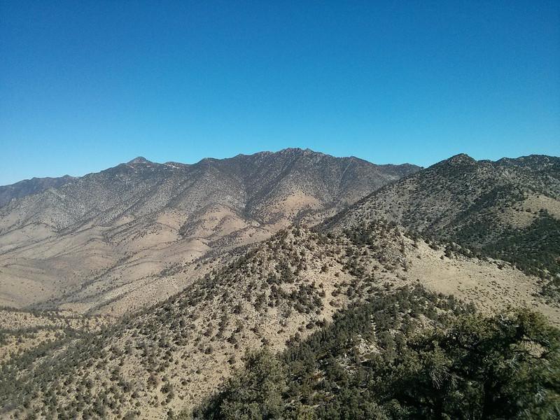 Proposal Peak summit view.<br /> <br /> Owens Peak and Mt. Jenkins.