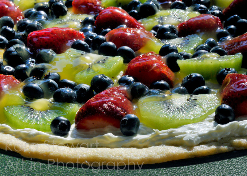 June 16, 2011<br /> <br /> Fruit Pizza<br /> <br /> I tried a fruit pizza recipe for the first time yesterday - yummy! Sugar cookie crust, cream cheese (low fat) and Cool Whip (no sugar) topping, then layer the fruit (I used strawberries, blueberries and kiwi as you can see), then glaze (oj, cornstarch, water, etc.). Really, really nice summer dessert! Thanks, Julia! :)
