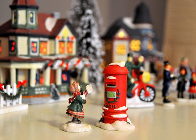 December 17, 2011  Christmas Village  Quick shot of our little Christmas village. We always have fun setting it up, and it's fun to get lost in the tiny perspective and pretend it is real!