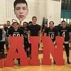 Members of the Groton-Dunstable High School football team show their support for Lain MacDonald