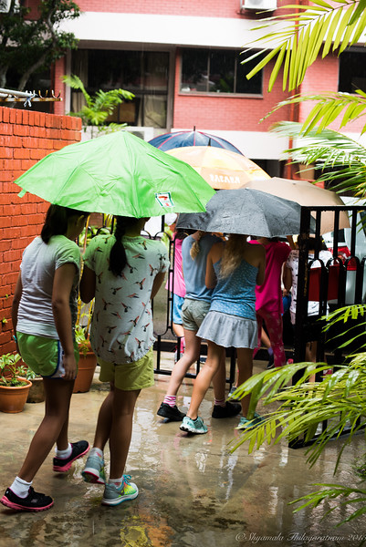 Singapore kids - off to the park for a laser 'war' - rain or not.