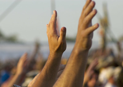 "Hands.  When Bruce sang ""We Shall Overcome"", thousands of people raised their hands."