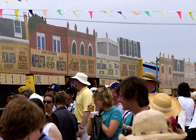 Pecan Catfish, muffuletta, Roast Beef Po-Boy, Crawfish Etouffe. A small sampling of the food available at Jazz Fest.  There are many of these stalls to choose from, offering up the best of Louisiana cooking. MMMMMMmmmmmm!!!   Come hungry!