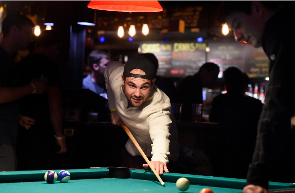 . BOULDER, CO - OCTOBER 25, 2018: University of Colorado senior Ben Hirschman takes a shot while playing pool with fellow CU senior Jared Reich, at right, at the Press Play Bar on Thursday night on Pearl Street in Boulder. For more photos of people drinking and hanging out at the bars near Pearl Street go to dailycamera.com (Photo by Jeremy Papasso/Staff Photographer)