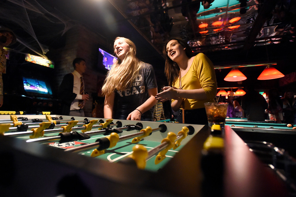 . BOULDER, CO - OCTOBER 25, 2018: University of Colorado juniors Hannah, at right, and Sydney, both who declined to give their last names, play a game of Foosball while hanging out at the Press Play Bar on Thursday night on Pearl Street in Boulder. For more photos of people drinking and hanging out at the bars near Pearl Street go to dailycamera.com (Photo by Jeremy Papasso/Staff Photographer)