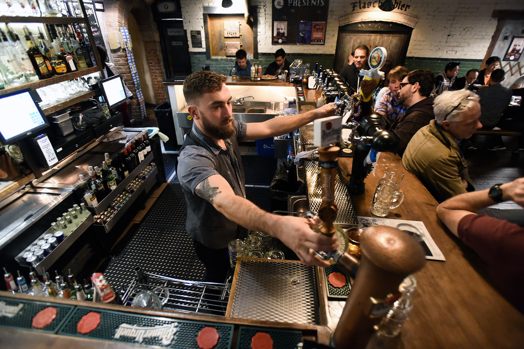 . BOULDER, CO - OCTOBER 17, 2018: Bartender Grady Righthand pours a draft beer for a customer at the Bohemian Biergarten on Wednesday night in Boulder. For more photos of younger people drinking on Pearl Street go to dailycamera.com (Photo by Jeremy Papasso/Staff Photographer)