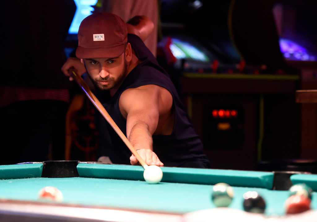 . BOULDER, CO - OCTOBER 17, 2018: University of Colorado alumni Sebastian Solis takes a shot during a pool game at the Press Play Bar on the Pearl Street Mall on Wednesday night in Boulder. For more photos of younger people drinking on Pearl Street go to dailycamera.com (Photo by Jeremy Papasso/Staff Photographer)