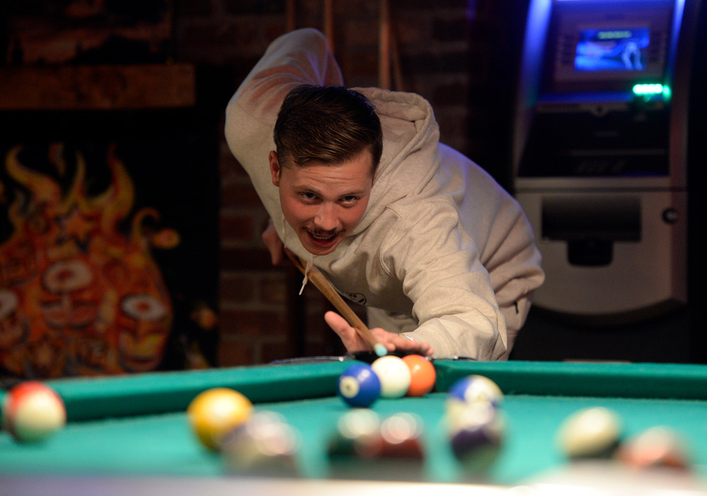 . BOULDER, CO - OCTOBER 17, 2018: University of Colorado alumni Bryant Jacobs takes a shot while playing a game of pool at the Press Play Bar on the Pearl Street Mall on Wednesday night in Boulder. For more photos of younger people drinking on Pearl Street go to dailycamera.com (Photo by Jeremy Papasso/Staff Photographer)