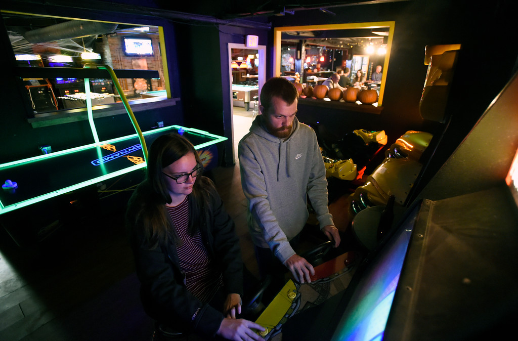 . BOULDER, CO - OCTOBER 17, 2018: CJ Johnson, left, and her husband Jake Johnson play an arcade game at the Press Play Bar on the Pearl Street Mall on Wednesday night in Boulder. For more photos of younger people drinking on Pearl Street go to dailycamera.com (Photo by Jeremy Papasso/Staff Photographer)