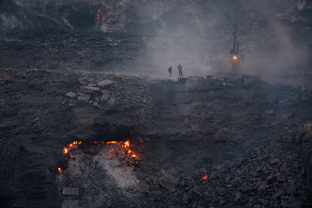 A coalmine seen in the afternoon. Fires everywhere.