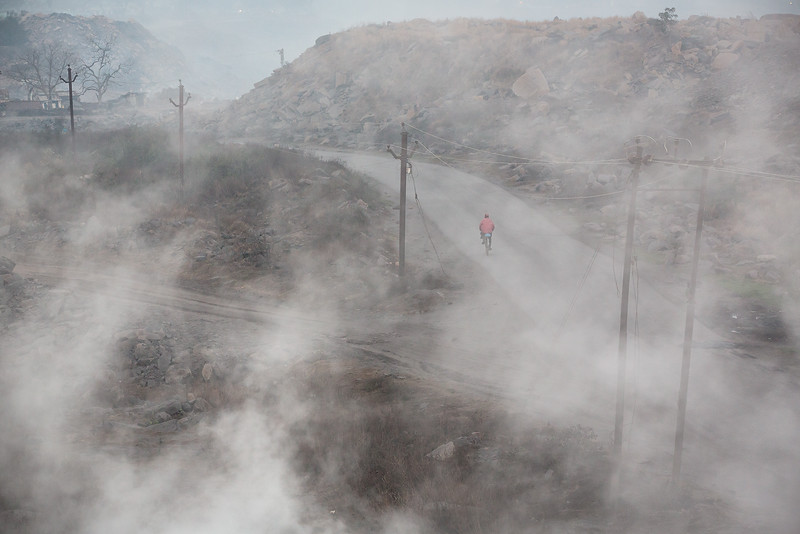 In the city of Jharia and surroundings, an underground fire has been burning since 1916 - or even longer according to the locals. The fire probably started when abandon coalmines was not properly closed. The fire evolved in to more than 70 underground fires. The inhabitants use the fire to warm themselves on cold winter nights, to dry clothes and sometimes even cook food.Fumes leaks out of all cracks and holes in the ground. Here from just outside the city of Jharia.