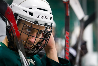 A Dartmouth hockey player on the bench at the annual Specimen Cup charity match between Geisel Medical School and UVM