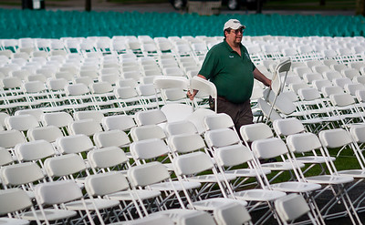 Chairs are set up in preparation for Commencement on the Dartmouth Green in Hanover, NH