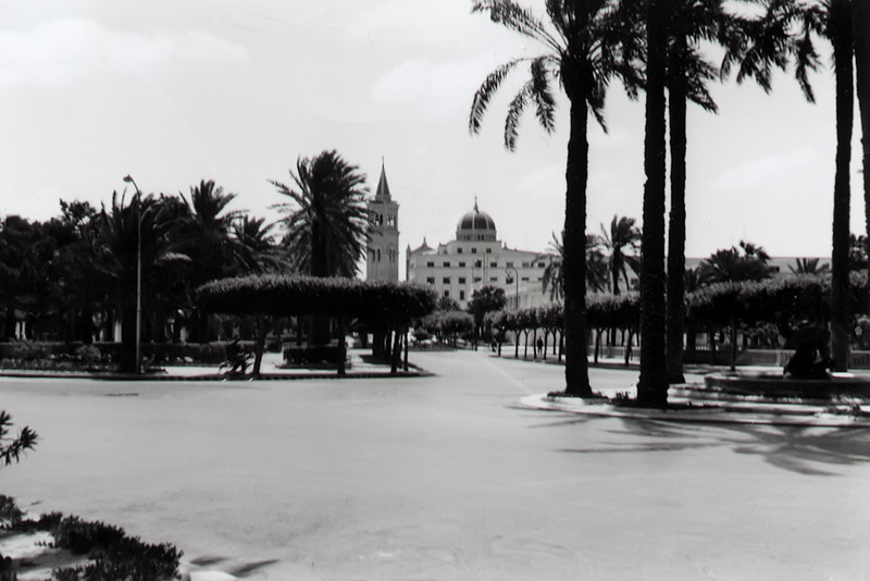 """The Cathedral of Tripoli, converted to a Mosque in the 1970's<br /> This image was printed reveresed. Gazelle Fountain is to the right. Sharia al Fatah runs across the picture.<br /> <br /> This is a ground view of this<br /> <br /> <a href=""""http://www.flickr.com/photos/libdas_gallery/90597557/in/photostream/"""">http://www.flickr.com/photos/libdas_gallery/90597557/in/photostream/</a>"""