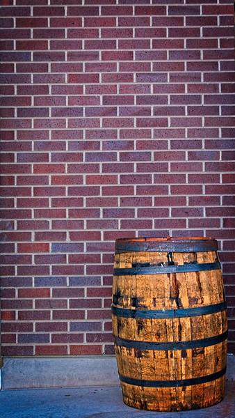 A brick wall having a barrel of fun at The Break