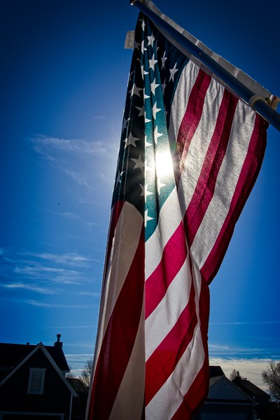 The US Flag on our front porch in Olatrhe, Kansas
