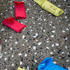 Red, Yellow, and Blue Newspapers on Sidewalk