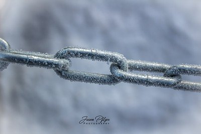 Close-up of a section of a frost-covered chain.  Enjoy and hold hands.