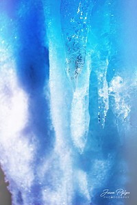 Icicle captured a moment in time while driving along the highways in Northern Minnesota. The blue hints of the ice formation drew me to the spot. The clarity of the ice drew me in even further. Enjoy and hold hands.