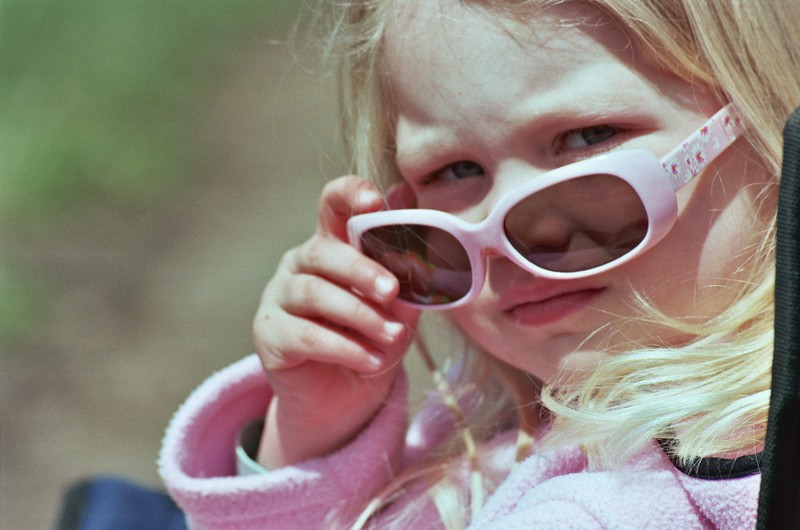 Young child with sunglasses.