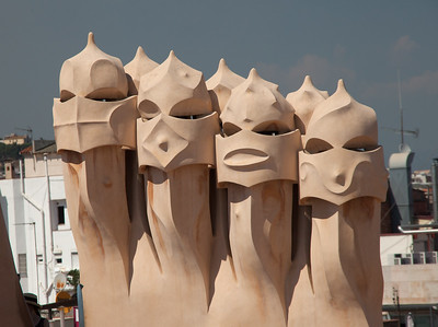 In Barcelona, Spain, Antoni Gaudi's chimneys on the roof of La Pedrera, an apartment house designed by him.