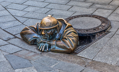 Cumil, the happy sewage worker statue, created in 1997 by artist Viktor Hulik in Bratislava, Slovakia. The literal translation of 'Cumil' is 'the watcher'. Some imagine that he's watching under women's skirts.