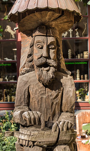 Statue outside a wood carver's shop in Vilnius, Lithuania.