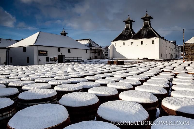 Snow covered whisky barrels at Ardbeg Distillery, Isle of Islay.