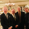 From left, Middlesex Community College President James Mabry of Bedford, Dr. Eric Meikle of Chelmsford, and Peter Kostoulakos, artist David Phaneuf and Vas Bogosian, all of Lowell