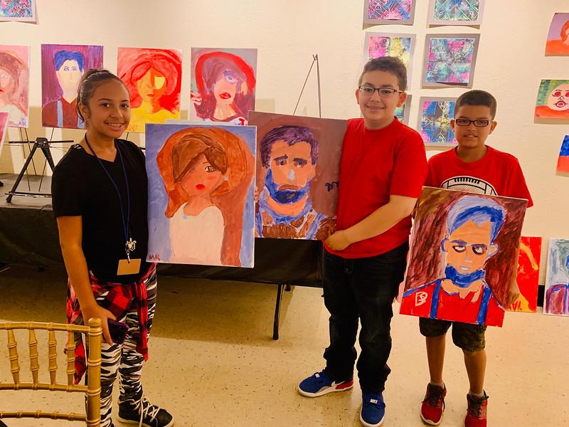 Artists, from left, Marangely Roman, David Santos, Varyel Monsalve of Lowell