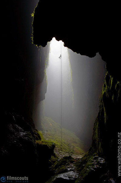 "Waitomo Caves. New Zealand.  100 metre abseil (rappel) into ""Lost World"" underground cave system. Model release # 497"
