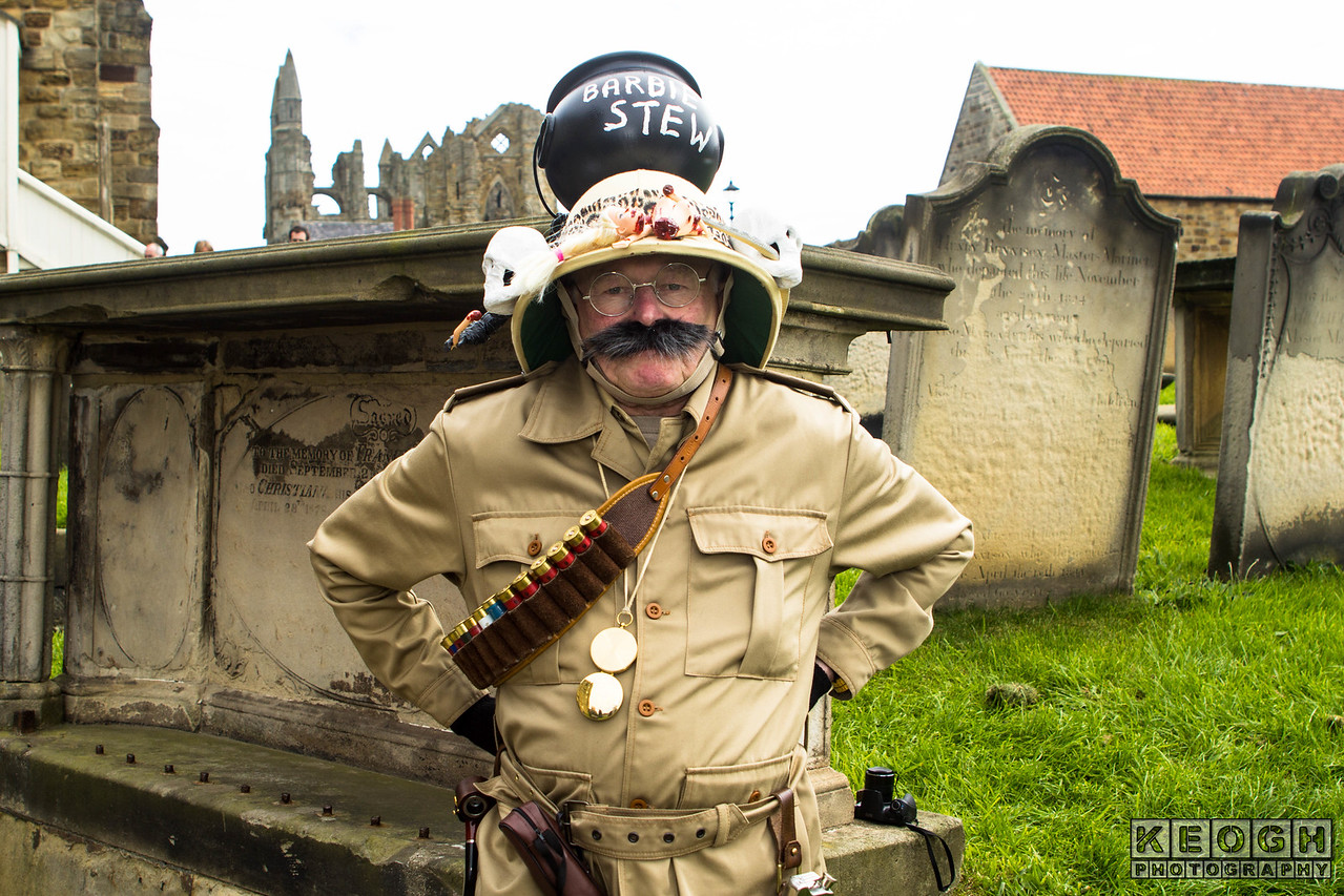 Bullet Belt, Goth, Gothic, Gun, Gun Belt, Hat, Helmet, Jacket, Military, Moustache, Pants, Steampunk, Trousers, Uniform, Whitby, Whitby Gothic Weekend, Whitby Gothic Weekend April 2017, Medals, Graveyard, St Mary's Chuch, Gravestones, Brown, Tan, Black