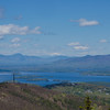 Mount Rowe bottom left. Looking across Winnepesaukee, the Sandwich (L) and Ossipee (R) to snow-capped Mount Washington.