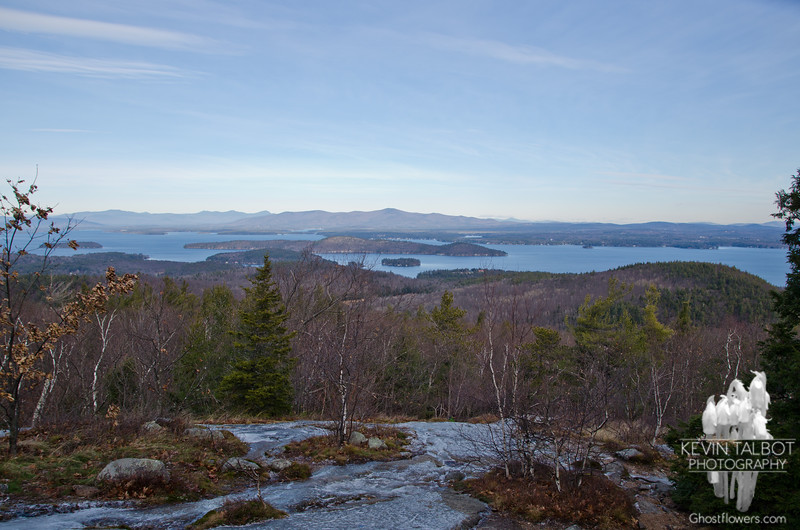 First views northeast across Winnepesaukee to the Ossipees and Sandwich Ranges.