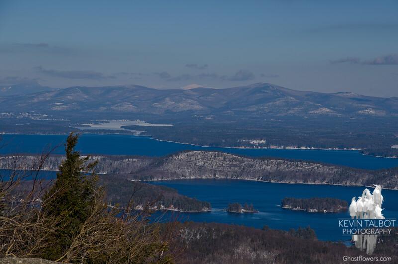 Zoom across Lake Winnepesaukee, Rattlesnake Island to the Ossipees and beyond to Washington.