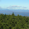To the northeast from the Belknap Firetower. L to R Osceolas, Tecumseh, Tripyramids, Sleepers, Whiteface and Passaconaway.