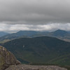 L to R Sandwich Dome, Whiteface and Passaconaway with Paugus shaded in the middle distance.
