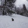 Emma leads up the ski trail.