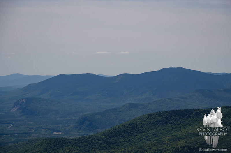 Zoom of the Moat Range, Mount Chocorua's summit cone peeks over North Moat. Whitehorse  & Cathedral Ledge in the bottom left...