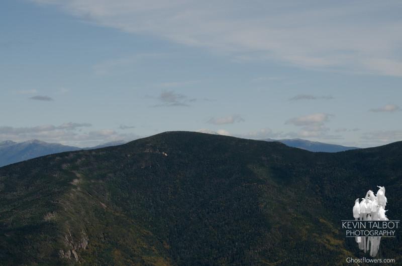 Washington peeks over North Twin.