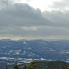 View west from summit. On the horizon L to R are Mount Chocorua, Paugus, whiteface, Passaconaway, The Sleepers and the Tripyramids.